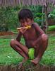 An Embera Indian boy enjoying some melon