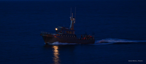 Fishing vesssel returning late to port in Homer