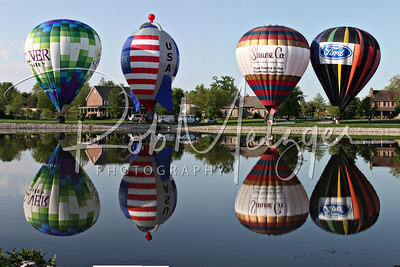 Project 365-120  Picture Perfect!  The Kentucky Derby Festival Great Balloon Race had quite a fantastic day to fly.  After dropping the streamer for the competition, I happened to be in the right place at the right time for these 4 balloons that lined up on the other side of this pond.  There was a 5th balloon, but I caught that separately.