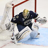University of Notre Dame Fighting Irish goaltender Mike Johnson (32) blocks a shot in the first period of the NCAA Frozen Four between the University of University of Minnesota Bulldogs and the Notre Dame Fighting Irish at the Xcel Energy Center St, Paul, MN. After the first period, UMD led 3-2.