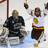 University of Minnesota Duluth Bulldogs winger Mike Connolly (22) celebrates a first period score as University of Notre Dame Fighting Irish goaltender Mike Johnson (32) looks on during the the NCAA Frozen Four between the University of University of Minnesota Bulldogs and the Notre Dame Fighting Irish at the Xcel Energy Center St, Paul, MN. After the first period, UMD led 3-2.