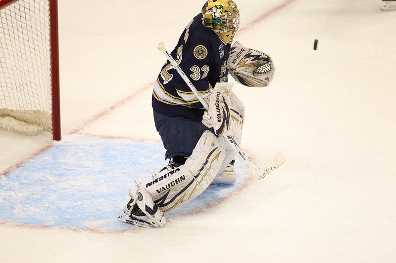 Goaltender Mike Johnson (32) positions himself in front of an oncoming shot in the first period of the NCAA Frozen Four between the University of University of Minnesota Bulldogs and the Notre Dame Fighting Irish at the Xcel Energy Center St, Paul, MN. UMD leads 3-2 after one period.