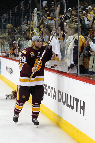 University of Minnesota Duluth Bulldogs defenseman Wade Bergman (28) shared the celebration with fans in winning the NCAA Frozen Four championship game between the University of University of Minnesota Bulldogs and the University of Michigan Wolverines at the Xcel Energy Center St, Paul, MN. UMD won the game 3-2 in overtime.