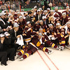 University of Minnesota Duluth Bulldogs pose for team photo with the national championship trophy at the NCAA Frozen Four between the University of Minnesota Bulldogs and the University of Michigan Wolverines at the Xcel Energy Center St, Paul, MN. UMD won 3-2 in overtime.