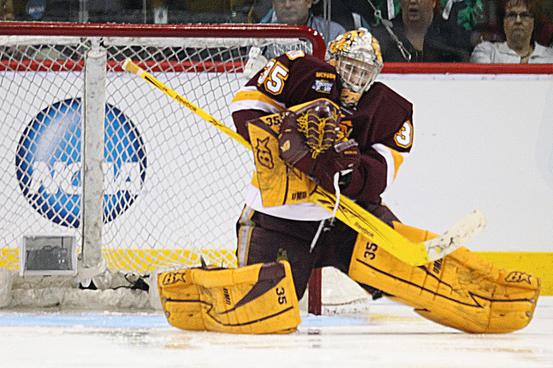 University of Minnesota Duluth Bulldogs goalie Kenny Reiter (35) huddles the puck for a save in the third period of the NCAA Frozen Four between theUniversity of Minnesota Bulldogs and the University of Michigan Wolverines at the Xcel Energy Center St, Paul, MN. The score was tied 2-2 after three periods of regulation play.
