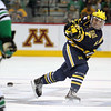 University of Michigan Wolverines defenseman Chad Langlais (7) releases a shot in third period of the NCAA Frozen Four between the University of Michigan Wolverines and the University of Minnesota Fighting Sioux at the Xcel Energy Center St, Paul, MN. Michigan wins the game 2-0 to advance to the championship game.