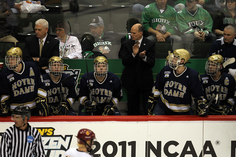 University of Notre Dame Fighting Irish head coach Jeff Johnson encourages his team in the second period of the NCAA Frozen Four between the University of University of Minnesota Bulldogs and the Notre Dame Fighting Irish at the Xcel Energy Center St, Paul, MN. Second period ended with the score of 4-2 UMD over Notre Dame.