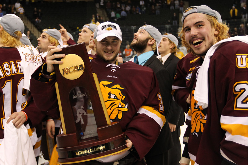 University of Minnesota Duluth Bulldogs goalie Kenny Reiter (35) and defenseman Justin Faulk (25) share the celebration of winning the national championships of the NCAA Frozen Four between the University of Minnesota Bulldogs and the University of Michigan Wolverines at the Xcel Energy Center St, Paul, MN. UMD won 3-2 in overtime.