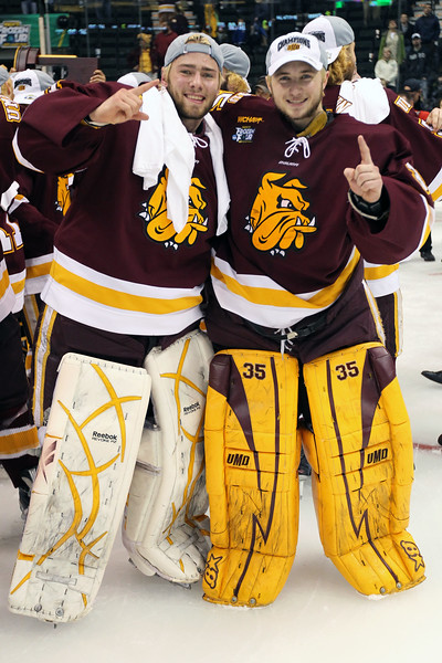 University of Minnesota Duluth Bulldogs goalies Kenny Reiter (35) and Aaron Crandall (31) celebrate winning the national championship, the NCAA Frozen Four between the University of Minnesota Bulldogs and the University of Michigan Wolverines at the Xcel Energy Center St, Paul, MN. UMD won 3-2 in overtime.
