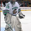 University of North Dakota Fighting Sioux goalie Aaron Dell (32) stakes his turf in the third period of the NCAA Frozen Four between the University of Michigan Wolverines and the University of Minnesota Fighting Sioux at the Xcel Energy Center St, Paul, MN. Michigan wins the game 2-0 to advance to the championship game.