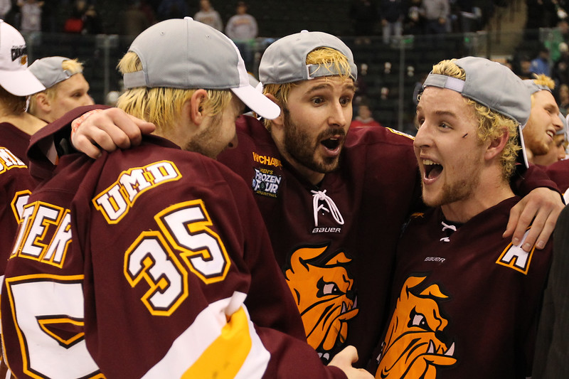 University of Minnesota Duluth Bulldogs teammates goalie Kenny Reiter (35), winger Justin Fontaine (37) and winger Mike Connolly (right) are almost in disbelief upon winning the national hockey championship, the NCAA Frozen Four between the University of Minnesota Bulldogs and the University of Michigan Wolverines at the Xcel Energy Center St, Paul, MN. UMD won 3-2 in overtime.