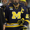 University of Michigan Wolverines team captain forward Luke Glendening (23) shakes hands at the conclusion of the NCAA Frozen Four between the University of Michigan Wolverines and the University of Minnesota Fighting Sioux at the Xcel Energy Center St, Paul, MN. Michigan wins the game 2-0 to advance to the championship game.