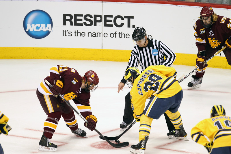 University of Michigan Wolverines forward Kevin Lynch (11) and University of Michigan Wolverines forward Louie Caporusso (29) faceoff in the first period of the NCAA Frozen Four championship game between the University of University of Minnesota Bulldogs and the University of Michigan Wolverines at the Xcel Energy Center St, Paul, MN. Michigan led 1-0 at the end of the first period.