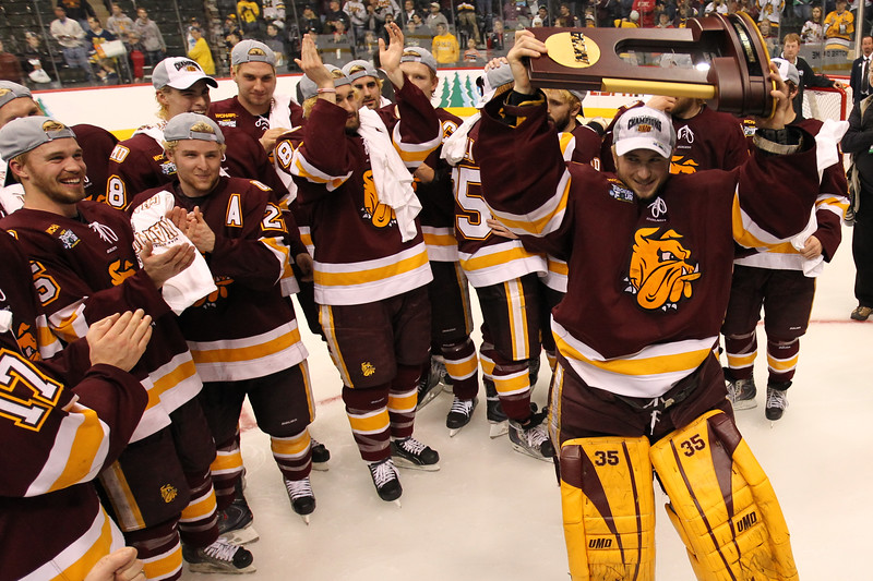 University of Minnesota Duluth Bulldogs goalie Kenny Reiter (35) raises the trophy overhead in celebration of winning the schools first national championship at the NCAA Frozen Four between the University of Minnesota Bulldogs and the University of Michigan Wolverines at the Xcel Energy Center St, Paul, MN. UMD won 3-2 in overtime.