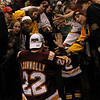 University of Minnesota Duluth Bulldogs winger Mike Connolly (22) shares the celebration with fans at the NCAA Frozen Four between the University of Minnesota Bulldogs and the University of Michigan Wolverines at the Xcel Energy Center St, Paul, MN. UMD won the national title 3-2 in overtime.