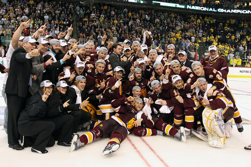 University of Minnesota Duluth hockey team posed with the national trophy for the NCAA Frozen Four championship game between the University of University of Minnesota Bulldogs and the University of Michigan Wolverines at the Xcel Energy Center St, Paul, MN. UMD won the game 3-2 in overtime.