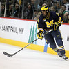 University of Michigan Wolverines forward Scooter Vaughan (3) advances the puck into the offensive zone in third period of the NCAA Frozen Four between the University of Michigan Wolverines and the University of Minnesota Fighting Sioux at the Xcel Energy Center St, Paul, MN. Michigan wins the game 2-0 to advance to the championship game.