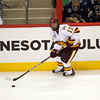 Wing Mike Seidel (17) controls the the puck in the third period of the NCAA Frozen Four between the University of University of Minnesota Bulldogs and the Notre Dame Fighting Irish at the Xcel Energy Center St, Paul, MN. UMD wins 4-3 over Notre Dame to advance to the final.