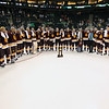 University of Minnesota Duluth Bulldogs surround their national championship trophy at the NCAA Frozen Four between the University of Minnesota Bulldogs and the University of Michigan Wolverines at the Xcel Energy Center St, Paul, MN. UMD won 3-2 in overtime.