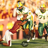 North Dakota State University Bisons running back Sam Ojuri (22) breaks through the line for a long gain at the football game between North Dakota State University and the University of Minnesota Gophers. North Dakota State won the game 37-24.