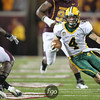 North Dakota State University Bisons wide receiver Ryan Smith (4) makes a cut for a long gainer at the football game between North Dakota State University and the University of Minnesota Gophers. North Dakota State won the game 37-24.