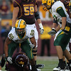 North Dakota State University Bisons defensive tackle Leevon Perry (69) tackles University of Minnesota Gophers quarterback MarQueis Gray (5) at the football game between North Dakota State University and the University of Minnesota Gophers. North Dakota State won the game 37-24.
