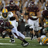 University of Minnesota Gophers running back Duane Bennett (22) extends for more yards at the football game between North Dakota State University and the University of Minnesota Gophers. North Dakota State won the game 37-24.
