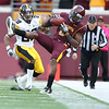 University of Minnesota Gophers wide receiver Da'Jon McKnight (6)makes a timely reception for 21 yards to keep the drive alive fourth quarter of a football game against the University of Iowa Hawkeyes at TCF Stadium in Minneapolis, Minnesota. The Gophers won the game 22-21.