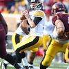 University of Iowa Hawkeyes quarterback James Vandenberg (16) drops back for a pass in a football game against the University of Minnesota Gophers at TCF Stadium in Minneapolis, Minnesota. Vandenberg went 16 of 24 for 177 yards and one touchdown and was sacked three times in their loss to the Gophers 22-21.