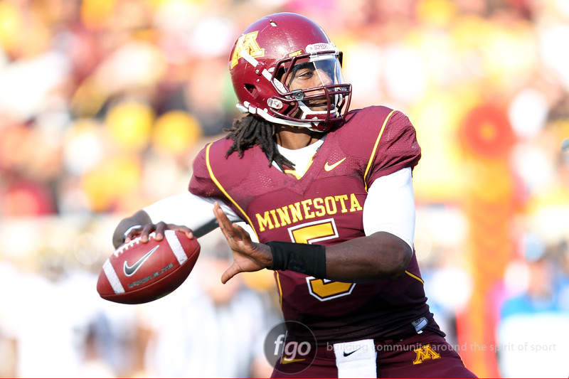 University of Minnesota Gophers quarterback MarQueis Gray (5) drops back for a pass in the football game against the University of Iowa Hawkeyes at TCF Stadium in Minneapolis, Minnesota. The Gophers won the game 22-21.