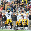 University of Iowa Hawkeyes wide receiver Marvin McNutt (7) lines up for a reception while head coach Kirk Ferentz (crossed arms) looks on from the sideline in a football game against the University of Minnesota Gophers at TCF Stadium in Minneapolis, Minnesota. McNutthad seven receptions for 101 yards in their loss to the Gophers 22-21.