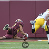 University of Minnesota Gophers wide receiver Devin Crawford-Tufts (80) makes a catch for 39 yards that leads to a field goal in the third quarter of a football game against the University of Iowa Hawkeyes at TCF Stadium in Minneapolis, Minnesota. The Gophers won the game 22-21.