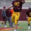 University of Minnesota Gopher wide receiver Matt Kloss (80) reaches for a pass in warmups at the University of Minnesota inter-squad Spring game  at the TCF Stadium in Minneapolis, MN.