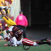 University of Minnesota Gophers MarQueis Gray (5) gets tripped up by University of Nebraska Cornhuskers defensive back Stanley Jean-Baptiste (16) at a football game between Nebraska and Minnesota at TCF Stadium in Minneapolis, Minnesota. The Cornhuskers won the game 41-14.