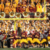 University of Minnesota Gophers kicker Chris Hawthorne (7) converts point after touchdown into the student section at the football game between the University of Nebraska Cornhuskers and Minnesota at TCF Stadium in Minneapolis, MN.  The Cornhuskers won the game 41-14.