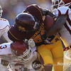 University of Minnesota Gophers wide receiver Malcolm Moulton (86) encounters New Mexico State's defensive back Jonte Green (1) and strong safety Donyae Coleman (3) who forces the fumble in the fourth quarter of a football game between New Mexico State versus University of Minnesota  game at TCF Stadium in Minneapolis, Minnesota. The fumble was recovered by Minnesota for a first down to keep the Gophers drive alive. The Gophers failed to score and New Mexico State went on to win the game 28-21.