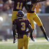 University of Minnesota Gophers defensive back Kim Royston (3) looks on as his teammates cornerback Troy Stoudermire (11) and defensive back Brock Vereen (21) celebrate Stoutermire's interception in the second quarter of a football game between New Mexico State versus University of Minnesota  game at TCF Stadium in Minneapolis, Minnesota. It was 14-7 at the half and New Mexico State went on to win the game 28-21.