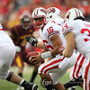 University of Wisconsin Badgers quarterback Russell Wilson (16) looks to hand off the ball to fullback Brady Ewing (34) in the football game against the University of Minnesota Gophers at TCF Stadium in Minneapolis, MN.  The Badgers won the game 42-13.