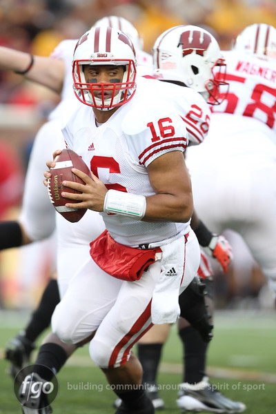University of Wisconsin Badgers quarterback Russell Wilson (16) rolls out in the football game against the University of Minnesota Gophers at TCF Stadium in Minneapolis, MN.  The Badgers won the game 42-13.