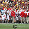 University of Wisconsin Badgers head coach Bret Bielema (center in red) watches his team from the sidelines as they play a football game against the University of Minnesota Gophers at TCF Stadium in Minneapolis, MN.  The Badgers won the game 42-13.