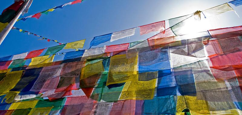PRAYER FLAGS IN THE SUN. BODNATH STUPA. [BOUDHA.] KATHMANDU. NEPAL.