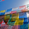 PRAYER FLAGS IN THE SUN. BODNATH STUPA. [BOUDHA.] KATHMANDU. NEPAL.
