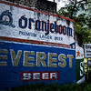 ORANJEBOOM AND EVEREST BEER ADVERTISING AT THE TRISHULI BRIDGE. PRITVY HIGHWAY. NEPAL.