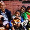 NEPALESE FAMILY IN THE TEMPLE. DASAIN FESTIVAL. GORKHA.