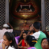 WORSHIPPING AT THE SETO BHAIRAB [WHITE DEMON]. GOLDEN MASK. DURBAR SQUARE. DASHAIN FESTIVAL. KATHMANDU.