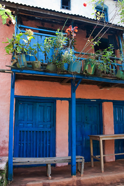 OLD HOUSE WITH BLUE WINDOWS. ON THE WAY TO THE KALIKA MANDIR. GORKHA. NEPAL.