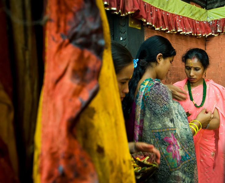 PREPARING OFFERINGS IN THE KALIKA MANDIR TEMPLE. DASAIN FESTIVAL. GORKHA. NEPAL.