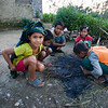 CHITWAN. CHILDREN TRY TO MAKE A FIRE. NEPAL.