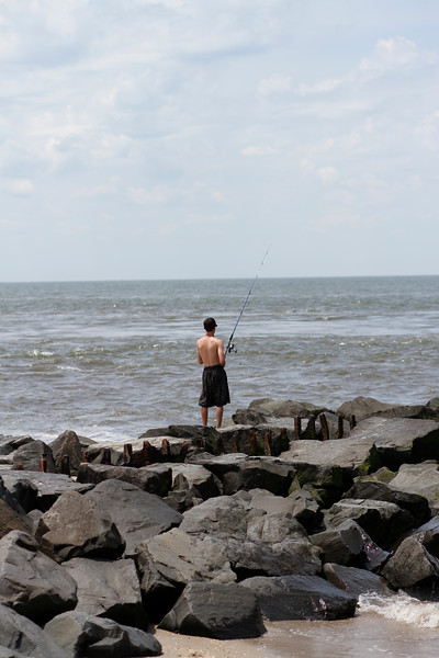Young fisherman...Cape May Lighthouse beach, Cape May, NJ