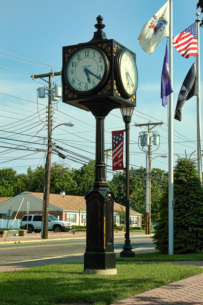 <center>IMG#1578 Downtown Glassboro...2013 Late Sunday afternoon by the hands of the clock at the corner of Main Street.<center>